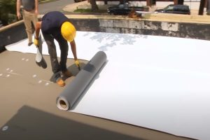 Kitchener Roofing workers flat roof on a commercial property