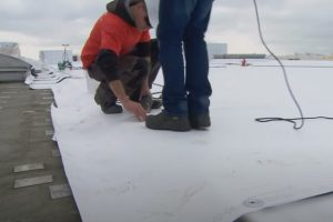 Flat Roof installation by JP Roofing workers