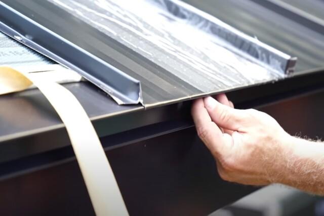 JP Roofing worker installing metal roof in Kitchener Ontario