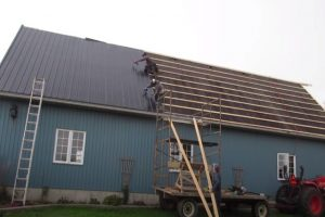 KItchener Roofing workers installing new metal roof.