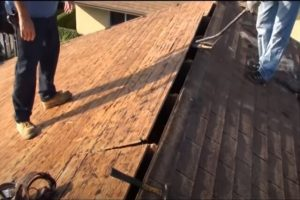 Kitchener Roofing workers doing re-roofing on a home