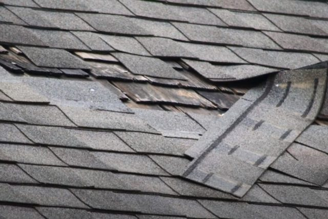 Kitchener Roofing missing shingles on a residential roof.